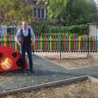 """Кметът на """"Източен""""  Иван Стоянов на нова детска площадка."""