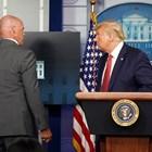 Агент от секретната служба придружава президента Доналд Тръмп при изведждането му по време на пресконференицията за короновируса. Снимка: Ройтерс