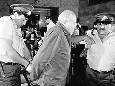 """ОБВИНЯЕМ: На разпитите, въпреки очните ставки с бивши лагеристи, Газдов отрича всичко.  Архивните снимки са от брошурата """"Без следа?"""" и са предоставени от Института за изследване на близкото минало."""