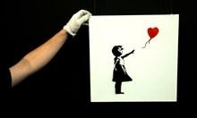 Защо Банкси унищожи собствената си картина в знак на протест