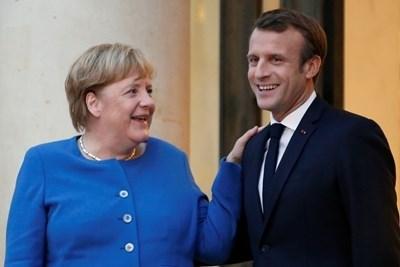 Ангела Меркел и Еманюел Макрон СНИМКА: Ройтерс