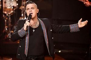 Роби Уилямс пее на концерт миналата година, СНИМКА: РОЙТЕРС